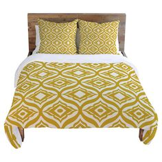 Yellow and white duvet cover with an ogee trellis motif. Designed by artist Heather Dutton.  Product: Duvet coverCon...