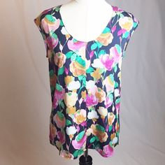"NWT J Crew factory floral cap-sleeve shirttail top Size 4. Beautiful floral design! Fits loose- pit to pit measurement when flat: 19"". 100% polyester  no trades J. Crew Tops Blouses"