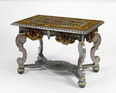 * Attributed to André-Charles Boulle French, Paris, about 1680 Oak veneered with tortoiseshell, pewter, brass, ebony, horn, ivory, and various natural and stained woods;  gilt-bronze mounts