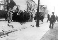 Jews being deported from Zawiercie, Poland by the German Police.