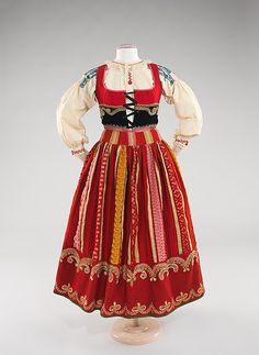 This is a traditional Western European dirndl. This particular piece is from the last quarter of the century and is Portuguese. The dirndl consists of a chemise with a laced up bodice over it. This piece can be found at the Met. Folk Clothing, Historical Clothing, Traditional Fashion, Traditional Dresses, Minho, Costumes Around The World, Costume Collection, Folk Costume, Textiles