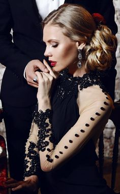 @miriamarielle and her escort at a black tie gala.