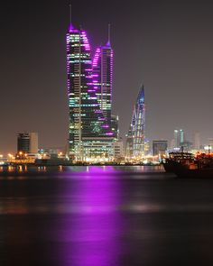 ✯ Manama at Night - capital city of the Kingdom of Bahrain City Lights At Night, Night City, Beautiful World, Beautiful Places, Kingdom Of Bahrain, Skyline, Thinking Day, Modern Buildings, Amazing Buildings