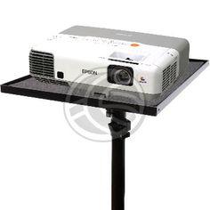 """Base de proyector para instalar en trípode. Esta base permite convertir un trípode de fotografía en un soporte de proyector portátil. En la parte inferior de la base dispone de rosca universal de 3/8"""", lo que permite acoplar la base a cualquier trípode o soporte que disponga de esta rosca. La base plana dispone de superficie de goma y de una cinta para evitar movimientos del proyector. Tamaño de la base del proyector: 30 x 37 cm. Base fabricada en metal de color negro y superficie de goma."""