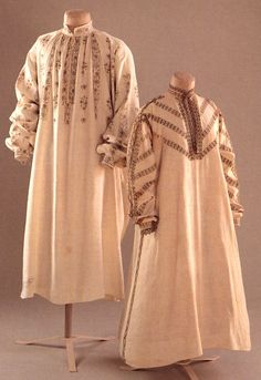 Elizabethan man's shirt, dated around 1580 - 1590. Jacobean woman's shift, dated around 1610. Rare undergarments, made of linen and embroidered with fine black needlework depicting natural and geometric patterns. Undershirts were principle pieces of the Elizabethan and Jacobean era, providing a washable, breathable layer beneath heavy doublets and kirtles. (Fashion Museum in Bath, England. Forgeng, Jeffrey. Daily Life in Elizabethan England. Santa Barbara: ABC-CLIO LLC, 2010.)