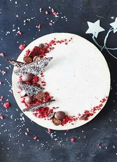 Raw Coconut & Raspberry Cheesecake -  Our Christmas showstopper! A light and creamy coconut cheesecake, with a tart raspberry centre and a crunchy choc buckini base. It is the perfect cake to bring to the table this festive season.