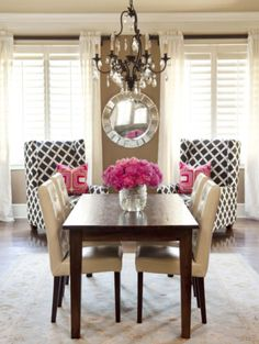 love the chandelier above the table. Not a fan of the pink accents though