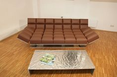 Chocolate bar convertible Euro lounger with foil wrapper coffee table by Iris Koser.