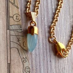 A personal favorite from my Etsy shop https://www.etsy.com/listing/231543829/light-blue-bullet-pendant-necklace-gold