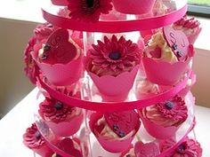 Cupcake wedding cakes are fresh and modern and a lot easier for the guests to have their pice of cake or take it away. These in my wedding colour and flower are just gorgeous