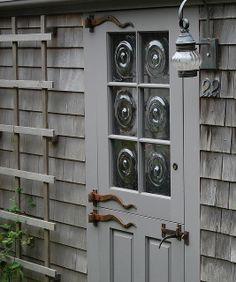 Grey/Gray door with bullseye windows Nantucket Cottage, Nantucket Style, Nantucket Island, Cozy Cottage, Cottage Style, Old Doors, Windows And Doors, Interior Barn Doors, Interior And Exterior