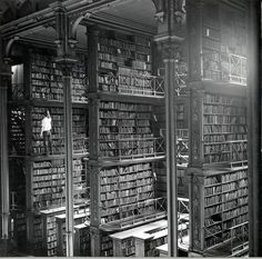 A man browsing for books in Cincinnati's cavernous old main library. The library was demolished in 1955. / via HistoryInPictures Twitter