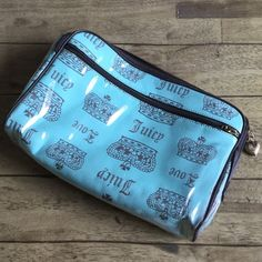 Mint Green Juicy Couture Cosmetic Bag Large mint green Juicy Couture Cosmetic bag. It's lined with plastic to protect the material, and has a few plastic pockets around the sides on the inside. Also has one large pocket on the outside. Juicy Couture Bags Cosmetic Bags & Cases