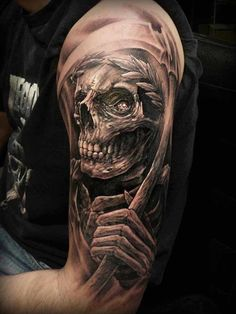 """Death has been personified as a skull carrying a scythe since the 1500´s however the title of """"Grim Reaper"""" can be traced back to the 1847. Death is not only amazingly personified in this horror tattoo, it has also been infused with a touch of terror, giving you the chills."""