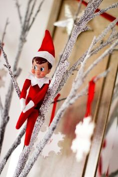 Elf on a shelf...in a tree. Gingerbread Christmas Party via www.karaspartyideas.com