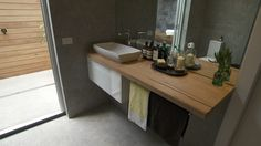 Brad & Dale, The Block - Reece bathroom with timber and grey tiles. Love the big mirror