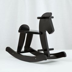 Shop Wooden Rocking Horse.  Our beautiful and sturdy wooden Rocking Horse Stallion is a new take on the classic rocking horse.  With a sturdy construction and rich black finish, you'll wish we made one for grownups to play with.