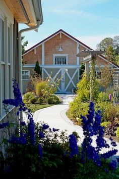 Walkway leading to renovated milk barn guest house - traditional - landscape - seattle - Lankford Associates Landscape Architects