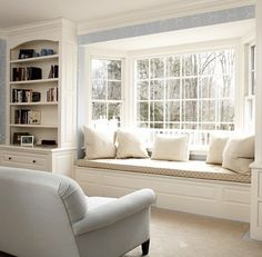 Make the most of every bit of space.  Build a window seat and shelves into a living room.