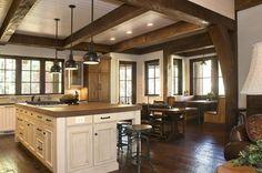 Rustic Lakehouse  kitchen - Beautiful. Love the booth eating area and the combination of paint and stain as well as the warmth of the largeopen space.