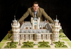 Palace from the past: Model maker Ben Taggart with the replica of Henry VIII's 'lost' Nonsuch