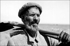 David Rubinger - In the hills of Judea. Israel. 1950, An immigrant from Iraq, employed in the laying of a new water pipe.