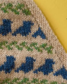 technique-thursday-working-in-pattern-while-increasing-or-decreasing by Ysolda. In stranded colourwork leaning decreases towards the edge being shaped and making sure to work them in the colour that matches the established pattern for that stitch will make them blend in almost imperceptibly.