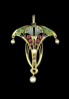 An art nouveau gold, enamel and gem-set pendant, circa 1900, the stylised flowering plant decorated in green and blue plique-à-jour enamel, circular-cut rubies, brilliant and single-cut diamonds and seed pearls. | © Bonhams 2001-2015