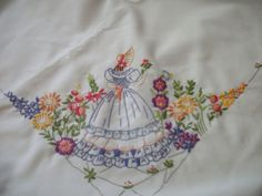 LARGE COMPLETED FREEHAND EMBROIDERY ON A TABLECLOTH OF CRINOLINE LADY