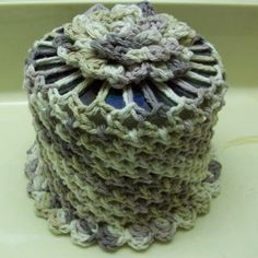 CD Double Roll Tissue Cover. Not bad or silly looking and it recycles CD's. It sure looks better than just plopping a roll on the back of the toilet or shelf... use any yarn [washable] to coordinate with your WC