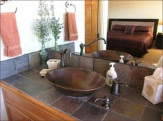 Tile Countertop | Master bathroom features a vessel sink and natural tile countertops.
