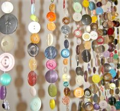 DIY button curtain. I used to play with buttons as a child. On my wedding day, my Mom gave me the old candy jar full of antique buttons. I've made t-shirts and pillows, but this idea takes the cake!