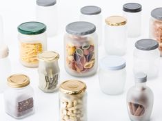 Microworks takes old jars and bottles and sandblasts them with their original labels still attached. The exposed glass becomes opaque so that when the stickers are removed, they reveal clear windows.