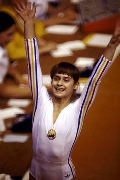 July Nadia Comăneci became the first person in Olympic Games history to score a perfect 10 in gymnastics at the Summer Olympics. 1976 Olympics, Summer Olympics, Olympic Gymnastics, Olympic Sports, Nadia Comaneci Perfect 10, Nadia Comaneci 1976, Olympic Flame, Gymnastics Pictures, Gymnastics Poses