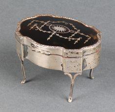 "Lot 475, An Edwardian silver and tortoiseshell pique quatrefoil trinket box on scroll legs Birmingham 1910 3 1/2"", est £80-120"