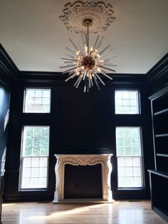 Opposites attract: Modern lighting and vintage ceiling medallion