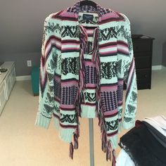 AE sweater/cardigan! AE tribal themed cardigan/sweater with fringe...so warm! American Eagle Outfitters Sweaters Shrugs & Ponchos