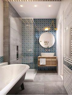 Dormitorio decorado en azul y blanco con cuarto de baño
