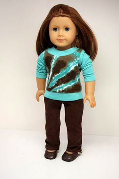 This trendy outfit will be a great addition to your American Girl's wardrobe. The aqua cotton knit tee has long sleeves and a velcro closure in the back. The tank top is brown and aqua tie dye and also has a back velcro closure. The skinny jeans are corduroy with top-stitching and real working pockets. By Diane of sewurbandesigns