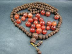 Currently at the #Catawiki auctions: A Bodhi bead Mala and 25 Carnelian prayer beads - Himalayan regions - from se...