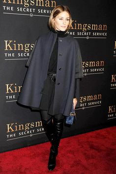 Olivia Palermo steps out in a draped navy coat and an otherwise all-black ensemble. We love her over-the-knee boots