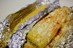 Bread + Butter: Oven-Roasted Corn on the Cob - Remove husks and silks and rinse.  Pat dry.  Spread with butter, sprinkle with Parmesan cheese, paprika, garlic, onion, Adobo, chili powder - wrap in foil and bake for 30 minutes at 350.