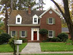 shutter colors for red brick house | Before: black, too-small louver shutters. The addition was white and ...