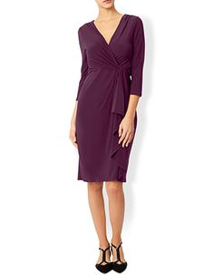 Cut from an ultra-flattering stretch fabric, our Svetlana knee-length wrap dress gathers at the waist with a draped overlay. The v-shaped neckline accentuates the bust, while the three-quarter length sleeves create a modern finish. Model wears UK 8/UK S/EU 36/US 4. Model height is 175 cm/5'9.