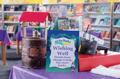 Place a wishing well coin collection container at the cashier station for everyone to see at checkout.