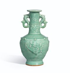 An Exceptional and Extremely Rare Chinese Celadon Dragon Vase, Yuan Dynasty.