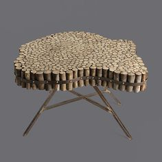 Ok, bear with me --a coffee table made out of wine bottle corks. Wouldn't it make a wonderful gift for your wine-loving parents? Inspired by this Voila! wooden coffee table.