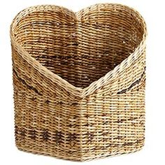 "Heart Basket  $60    The heart is many things: A vital organ, a lonely hunter, a sleeve ornament—and now, a cute Pier 1 basket. Fill it with love, magazines, yarn, kittens or anything else that your you-know-what desires.  Natural  18.5""W x 14.38""D x 19.25""H  Banana bark, rattan  Indoor use only  Exclusively Pier 1 Imports"