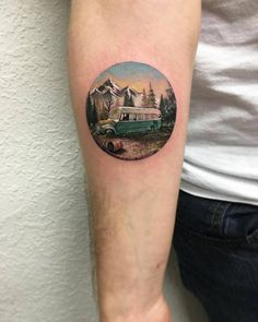 Into The Wild inspired circle tattoo on the right inner forearm.
