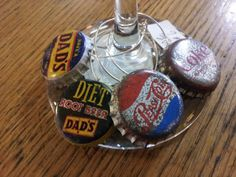 We made about lots of these. Old, vintage, soda pop caps are now wine glass charms, or regular.charms, or pendants, or earrings or ? $2 each